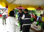 Chan Chee Kong, MBPJ Councillor receiving a Token of Appreciation from RT Gasing Indah